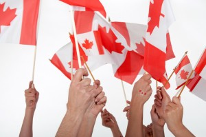 Canadian citizenship hands waiving flags