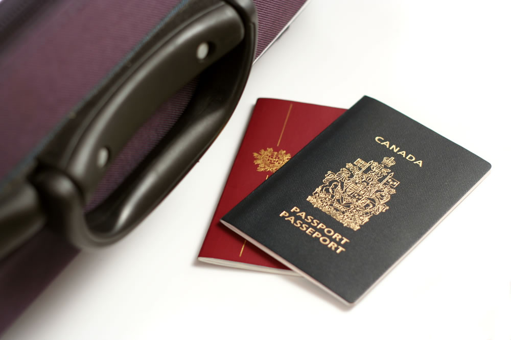 Canadian passport with luggage